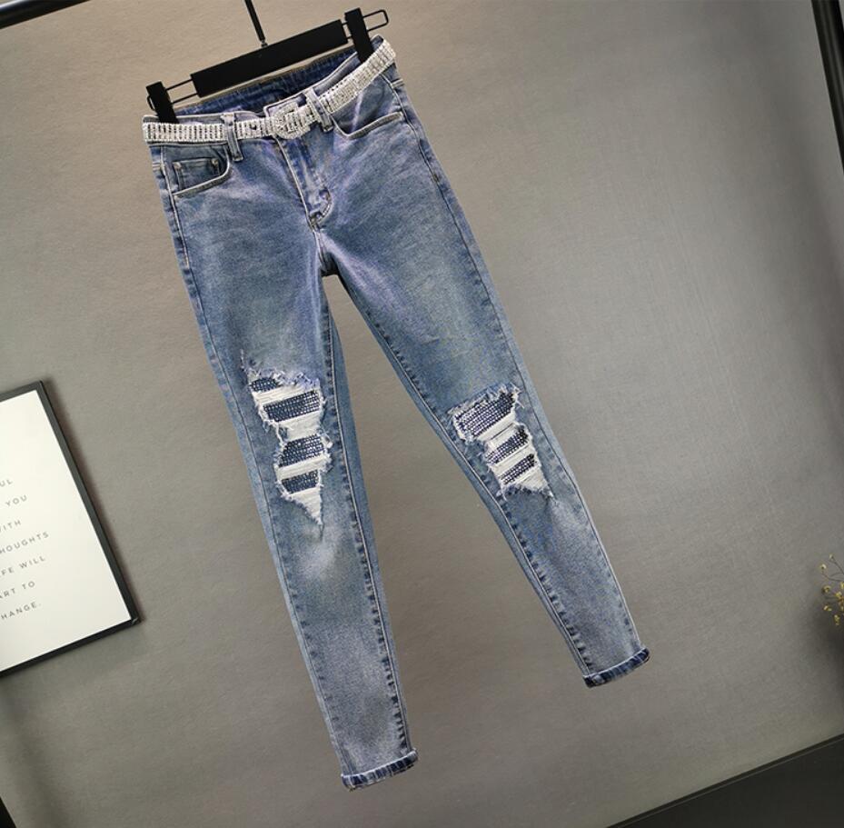 Jeans women 2020 spring new European station stretch Slim high waist hole hot rhinestone feet pants q549