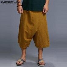Streetwear de los hombres pantalones Harajuku Irregular pantalones de harén  de entrepierna longitud cordón ancho de 413a8364a4f