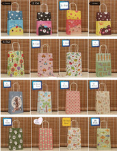 20pcs/lot-21*13*8cm-16style Small Size Cartoon Kraft Paper Bag with Handles Party Wedding Festival Gift Bags(China)