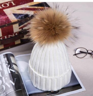 Free shipping Polan Warm winter thick wool knitted fashion lady 15CM Korean hat raccoon ball wool hat<br>