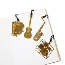 50 Pcs/lot Golden Music Bookmarks Ukulele Piano Drum Kit Saxophone Designs Metal Bookmark Gift Book Marks(China)