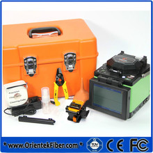 Free Shipping Orientek T40 FTTH Fiber Optic Splicing Machine Optical Fiber Fusion Splicer Welding Machine w/ Fiber Cleaver