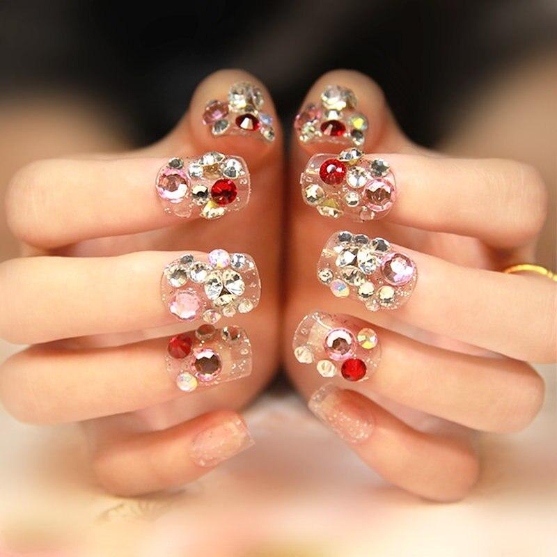 Фото украсить ногти стразами