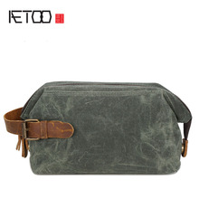 AETOO Men and women hand wrapped in oil wax canvas wash bag retro hand bag head layer of leather wrist bag(China)