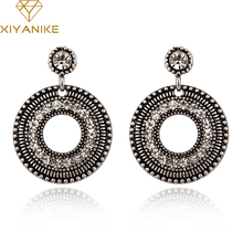 Buy XIYANIKE 2017 New Arrival Fashion Punk Exaggerated Vintage Rhinestone Round Big Drop Earrings Women Accessories E985 for $1.16 in AliExpress store