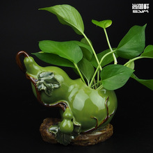 A small gourd flower creative Shiwan doll handmade ceramic vase Home Furnishing dining room modern decoration accessories