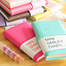 Special offer lovely smile face set pad smile leather notebook diary 2 pcs/pack mixed color Notebook Mini Student notebook(China)