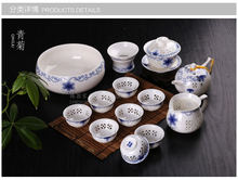 Chrysanthemum of a complete set of blue and white crystal and transparent ceramic hollow out purple ice crack kung fu tea set
