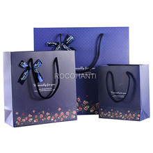ROCOHANTI 10X Fashion Dark Blue Floret Wave Point Bowknot Business Gift Bag Paper Shopping Bags With Twisted Handles(China)