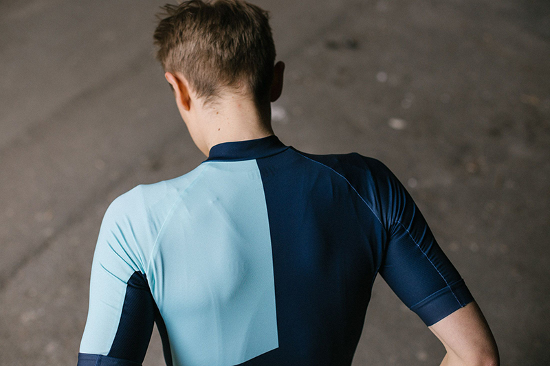 Backside of Green with blue cycling jersey from cycling kit