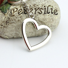 Hot Sale Creative Women Purse Bag Jewelry New Arrival Hollow Heart Shape Clear Crystal Keychains Charm Gift Novelty Items