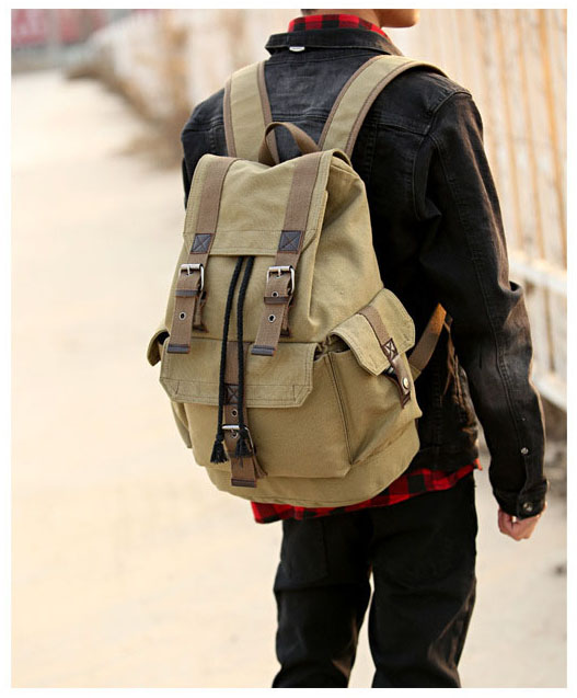 a guy with a beige carrying a vintage backpack on his shoulders