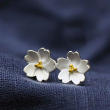 Cherry blossom with white petal and yellow flower bud  stud earing silver plated  Diameter 7mm