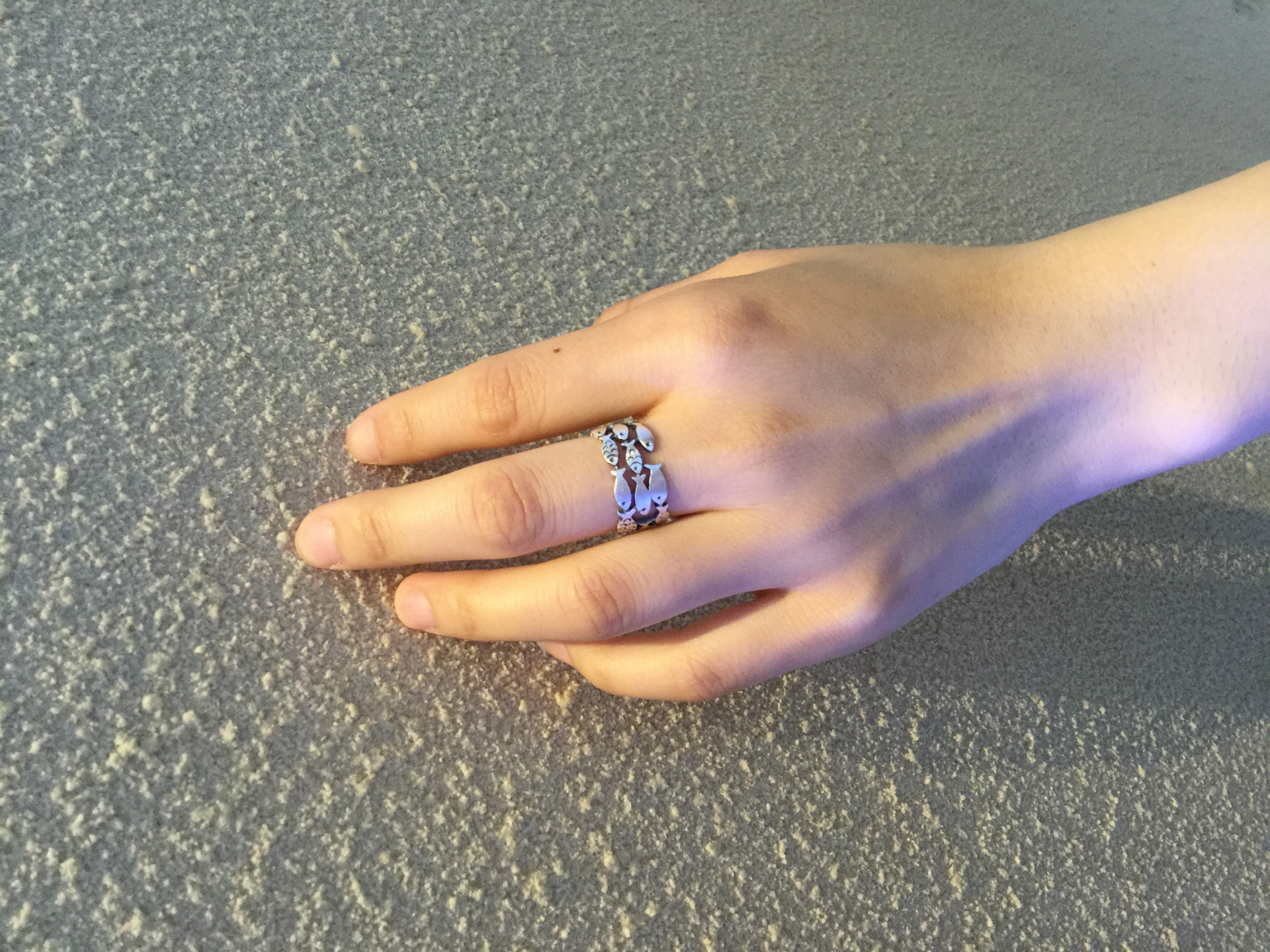 Stunning 925 Sterling Silver Swimming Fish Ring in model in hand
