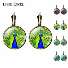 LIEBE ENGEL Beautiful Peacock Glass Cabochon Earrings For Women Fashion Bronze Jewelry Christmas Gifts Stud Earrings NEW(China)