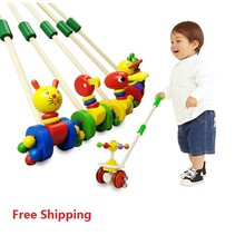 Free Shipping! Baby Wooden Hand Frog Push And Pull Animal,Toddler Toys Walker Children Kids Toy Car Outdoor Sports juguetes