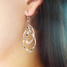 Classic fashion super shiny alloy multilayer  earrings twisted earrings bicyclic lady OL earrings free shipping