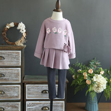 Fine children's clothing 2017 autumn new girl long sleeve tie printed rose personalized sweater + pants skirt two sets