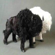 a pair of new simulation cow toys lifelike handicraft black and white bison dolls gift about 35x21cm