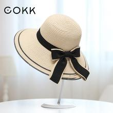 COKK Sun Hat Big Black Bow Summer Hats For Women Foldable Straw Beach Panama Hat Visor Wide Brim Femme Female 2017 New(China)