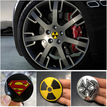 56mm Car Aluminium Superman Skull Head Batman Wheel Center Hub Cap Emblem Nuclear Radioactive Wheel Stickers Universal Fit(China)