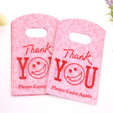 Hot Sale New Style Wholesale 50pcs/lot 9*15cm Red Thank You Shopping Gift Packing Bag With Smile Face Mini Plastic Gift Pouches
