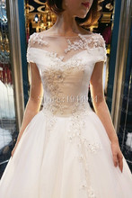 Sexy Ball Gown Wedding Dresses Real Image Cap Sleeves Lace Applique Court Train White Bridal Dresses China Online Store
