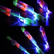 50PCS LED Light Flying Sling Helicopter Rocket Arrow Frisbee Flyer Boomerang Toys(China)