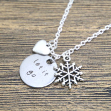 12pcs/lot  Inspired Elsa Let It Go Necklace Silver tone heart snowflake for women or girls.