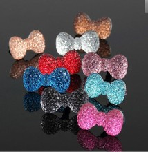 Wholesale Colorful Cute Crystal Bowknot Universal Earphone 3.5 mm Ear Cap Dock Dust Plug for iPhone iPod cell phone 1000pcs/lot(China)
