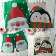 100pcs 14*20cm OPP DIY Stand Up Pouch Christmas Santa And Penguin Partten Gift Packaging Bag Cookie and Candy Plastic Bags B083(China)