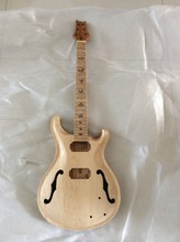 One piece of unfinished electric guitar , PRS guitar , guitar body and neck are made of Mahogany