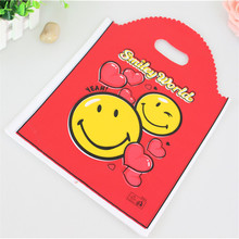 Hot Sale New Design Wholesale 50pcs/lot 25*35cm Large Shopping Plastic Bags With Handle Smile Face Packaging Gfit Bags