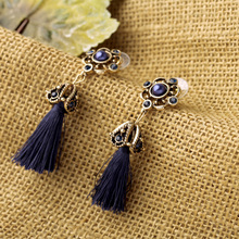 European and American fashion accessories manufacturer direct wholesale retro hollow out ms alloy tassel earrings