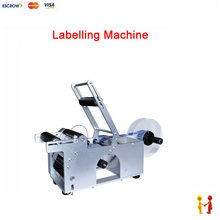 Semi-automatic round bottle labeling machine stickers used in PET bottles, plastic/glass/metal bottles(China)