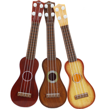 Exuqisite Children 4 String Guitar Simulation Early Childhood Educational Guitar Toys(China)