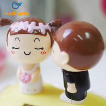 LeadingStar Solar Powered Kissing Bride Groom Toys Novelty Solar Dancing Kiss Doll Valentine Gift Home Car Decoration funny zk30(China)
