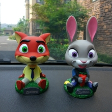 ZOOTOPIA Head Shaking Dolls Car Action Figure Toys Nodding Dolls Car-Styling Robot Head Shaking Toys Auto Ornament Decoration(China)