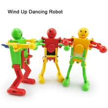 3pcs/lot New Wind up Dancing Robot Toy Funny Baby Design Spring Toys For Children Baby Clockwork Minifigures Kids Dolls RT101