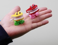 Wind up toy jumping walking funny cute laughing white teeth random color one pcs(China)