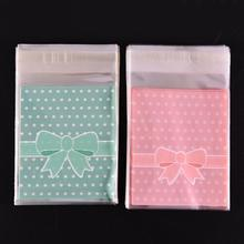 100Pcs/bag Gift Sealing OPP Plastic Lovely Pink Blue Bow Adhesive Cake gift Packages Cookie Candy Pack Christmas Paper bags