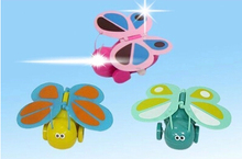 Classic a clockwork toy wholesale color spring butterfly / color chain Butterfly baby toy juguetes thomas and friends
