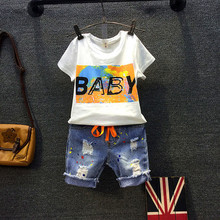 2016 New kid apparel Boys Summer Clothing Baby girls cartoon letter printed T-shirt ripped hole Short jeans Kids costumes