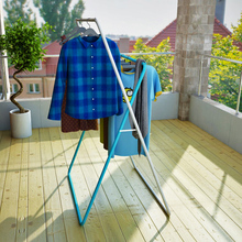 The wrought iron folding clothes hanger landing type X double pole racks indoor and outdoor clothes airer(China)