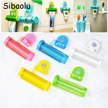 SIBAOLU 1 pc Plastic Rolling Tube Squeezer Useful Toothpaste Easy Dispenser Bathroom Holder Free Shipping(China)