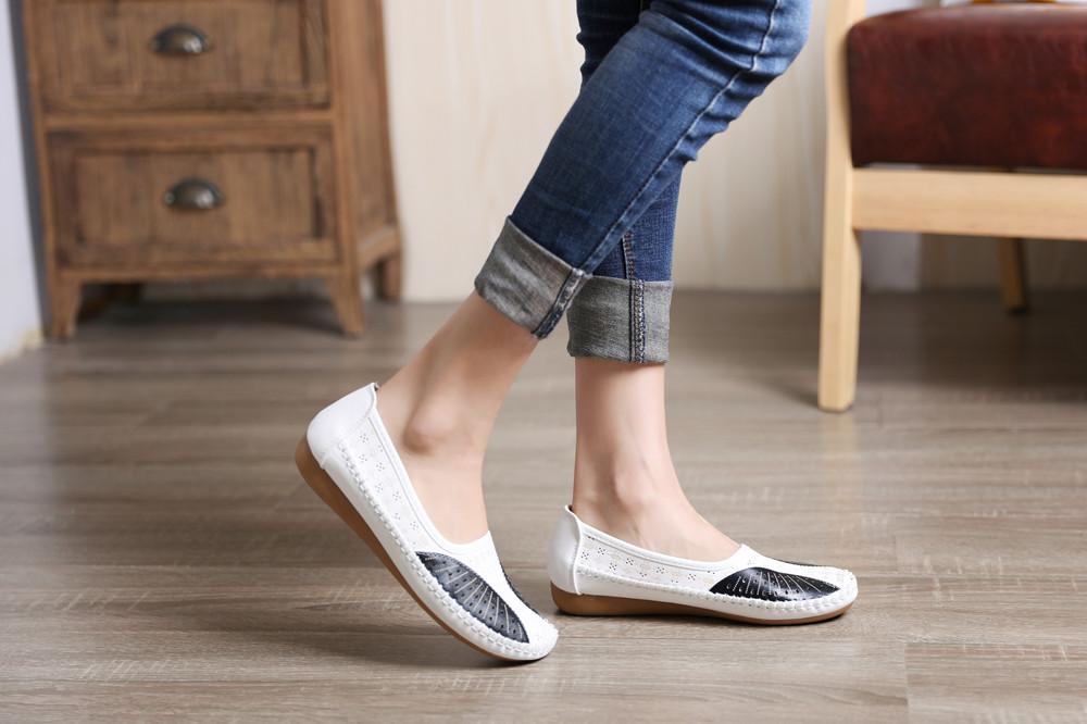 Valged kunstnahast kingad naistele