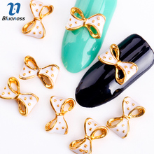 Blueness 10Pcs Golden Alloy Glitter 3d Nail Bows Art Decoration With Rhinestones Nails Charms On Nails Salon Supplies TN295(China)