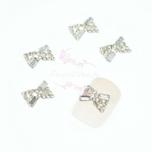 20PCS/LOT 7x10MM Silver Plated Hollow Out Design Bow Shape Clear Glass Rhinestones 3D Nail Art Jewelry Alloy Charms DIY Decor(China)