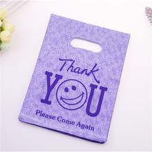 New Design Hot Sale Wholesale 100pcs/lot 15*20cm Purple Smile Face Packaging Bags Thank You Shopping Plastic Gift Bags