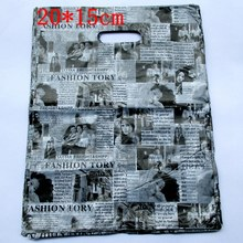 100pcs/lot English Newspaper Design Plastic Gift Bag 20*15cm Clothes Jewelry Packaging Bag Big Plastic Shopping Bags 152021(China)